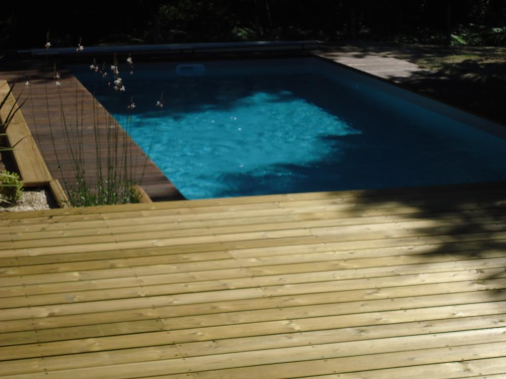 terrasse en pin US et tour de piscine en Itauba à Lüe (40210)